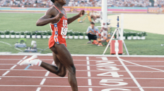 Carl Lewis crosses the line at the 1984 LA Olympics