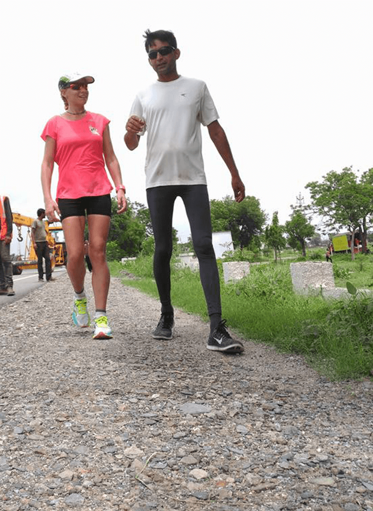A momentary breather for two ultra-runners at The Great India Run