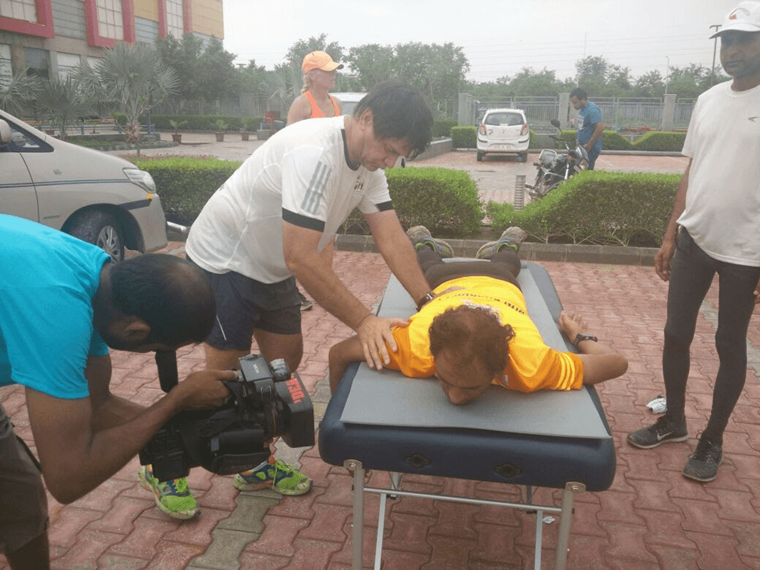 Yuri working on Arun on Day 2 of The Great India Run