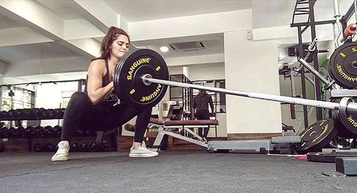 Annabel Da Silva showing her technique for landmine squats
